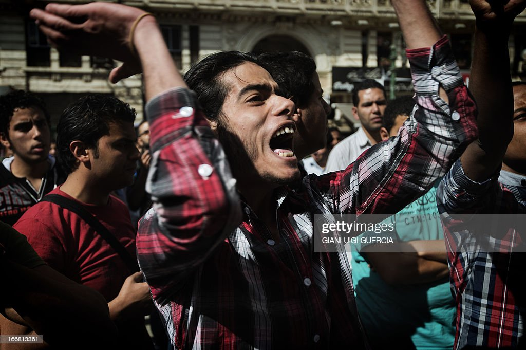 Members of the 6th of April movement and relatives of protester killed during the 2011 Egyptian revolution shout anti-government slogans and demand the release of political prisoners during a demonstration outside the Egyptian High Court in Cairo on April 17, 2013. A retrial of former Egyptian president Hosni Mubarak over his role in the deaths of protesters in 2011 is to open on May 11, judicial sources told AFP. AFP PHOTO/GIANLUIGI GUERCIA