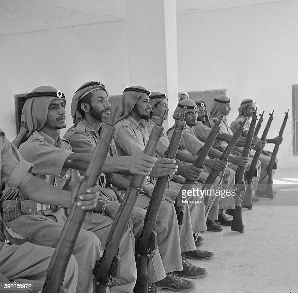Members of the Abu Dhabi defence force pose for the camera in the grounds of the Royal Palace July 1965