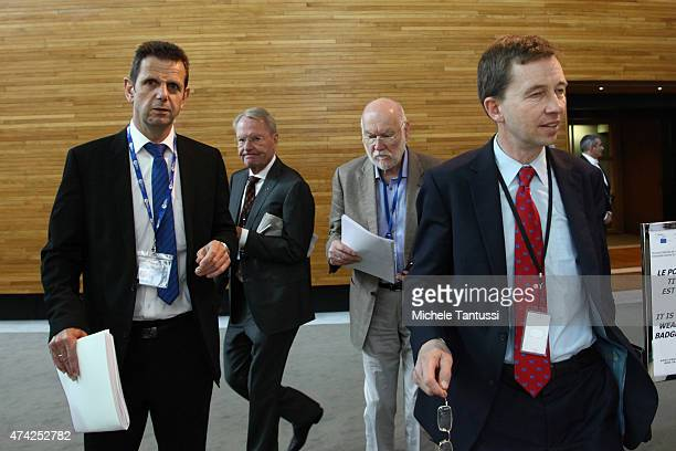Members of the AFD far right party Bernd Lucke Joachim Starbatty HansOlaf Henkel and Bernd Koelmel leave the plenary session of the European...