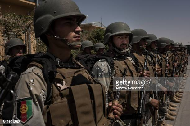 Members of the Afghan Civil Order of Police stand in formation for the arrival of local leaders at Camp Bost on September 11 2017 in Helmand Province...