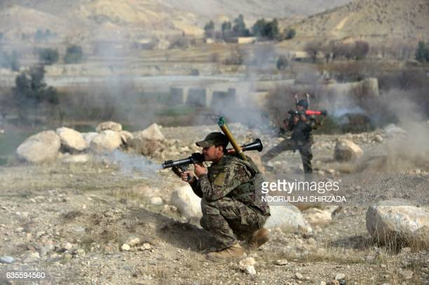 Members of the Afghan security force fire rocketspropelled grenade launchers during an ongoing an operation against Islamic State militants in Kot...