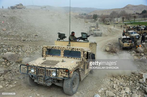 Members of the Afghan security forces patrol during an ongoing an operation against Islamic State militants in Kot district of Nangarhar province on...