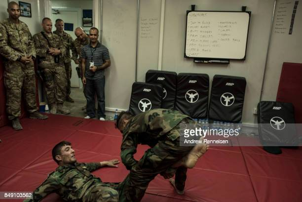 Members of the Afghanistan Air Force demonstrate fighting tactics taught to them by US Air Force advisors on September 9 2017 at Kandahar Air Field...