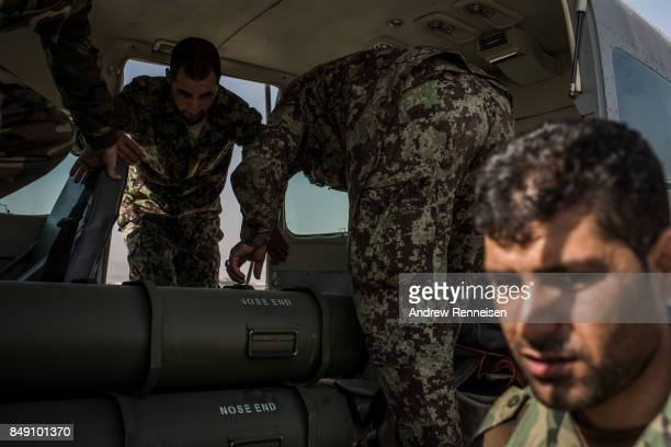 Members of the Afghanistan Air Force load ammunition onto a plane on September 9 2017 in Kabul Afghanistan Currently the United States has about...