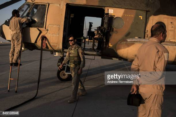 Members of the Afghanistan Air Force prepare a Mi17 helicopter for a flight on September 9 2017 at Kandahar Air Field in Kandahar Afghanistan...