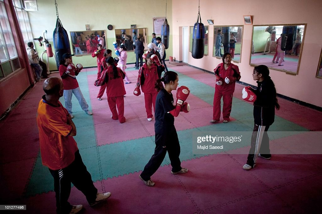 pashtun tribesmen and children living on the outskirts of kabul members of the women s national boxing team take part in a training session in the