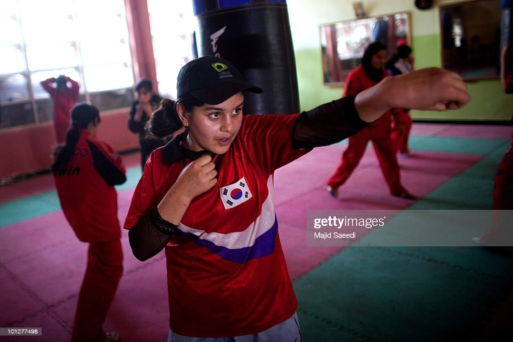 pashtun tribesmen and children living on the outskirts of kabul members of the women s national boxing team train in the national olympic after a training
