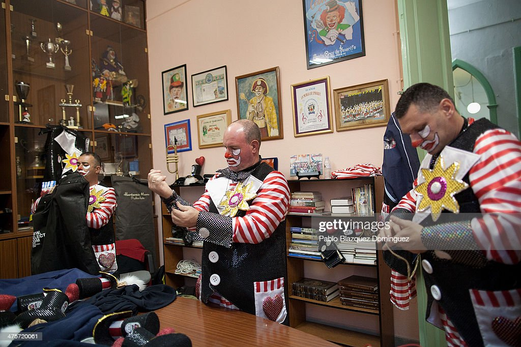 Members of the 'Afilarmonica NifuNifa' carnival group prepare at their headquarters before they take part in the opening parade of the carnival on...