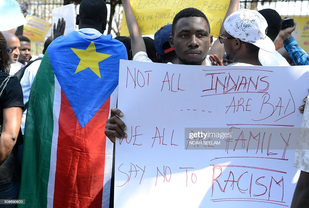 Members of the African Students Association hold placards during a protest in Hyderabad on February 6, 2016, in support of Tanzanian nationals assaulted by a local mob in Bangalore. Indian authorities suspended two policemen and made four more arrests over a mob attack on a Tanzanian student in Bangalore, police said February 5, in a case that has caused widespread outrage. AFP PHOTO / Noah SEELAM / AFP / NOAH SEELAM