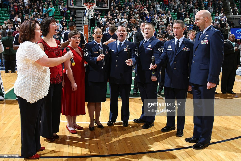 Members of the Air Force choir sing to commemorate Veterans Day before the Utah Jazz matchup against the Denver Nuggets at EnergySolutions Arena on November 11, 2013 in Salt Lake City, Utah.
