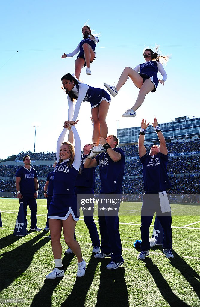 Members of the Air Force Falcons Cheerleaders perform during the game against the Notre Dame Fighting Irish at Falcon Stadium on October 26, 2013 in Colorado Springs, Colorado.