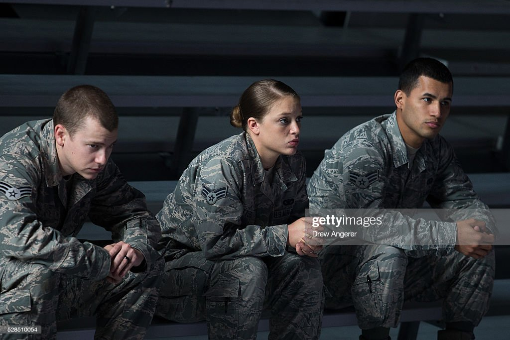 Members of the Air Force wait for the start of a comedy show organized by United Services Organizations (USO) for members of the military and their families, at Andrews Air Force Base, May 5, 2016, in Joint Base Andrews, Maryland. The program is also being live streamed for active duty service members stationed at bases domestically and abroad.