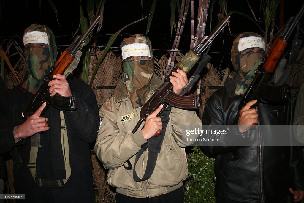 CONTENT] Members of the Al Aqsa Martyrs Brigade, which is affiliated with the Palestinian Fatah faction, at a location in the central Gaza Strip, south of Gaza City. The photo was taken at a time of rising tension between Fatah and its Islamist rival Hamas. In June 2007, Hamas defeated Fatah in a battle for control of the Gaza Strip. In Feb 2013, the two factions have not yet achieved reconciliation.