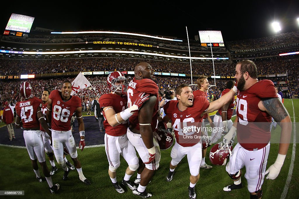 Members of the Alabama Crimson Tide celebrate after winning in overtime against the LSU Tigers at Tiger Stadium on November 8 2014 in Baton Rouge...