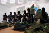 Members of the alAqsa Martyrs Brigades an armed offshoot of the Fatah movement loyal to president Mahmud Abbas shows off a balaclavas and other...