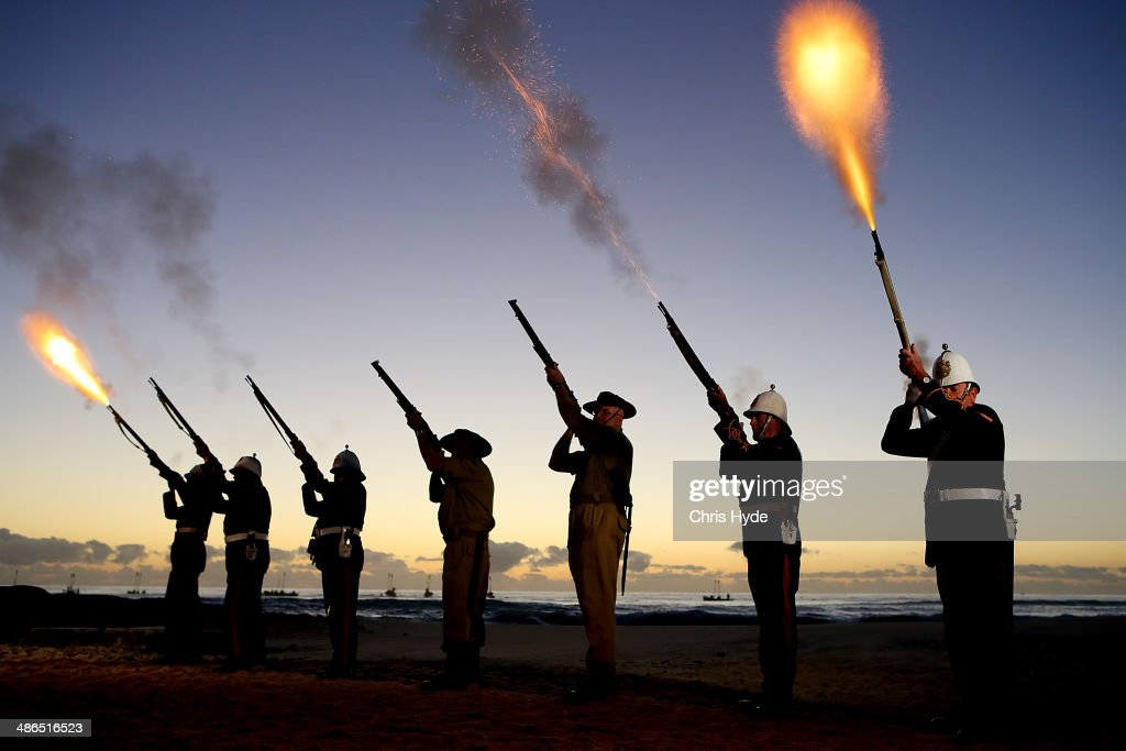 Members of the Albert Battery shoot a volley of fire during the ANZAC dawn service at Currumbin Surf Life Saving Club on April 25, 2014 in Gold Coast, Australia. Veterans, dignitaries and members of the public today marked the 99th anniversary of ANZAC (Australia New Zealand Army Corps) Day, April 25, 1915 when allied First World War forces landed on the Gallipoli Peninsula. A public holiday in both Australia and New Zealand, commemoration events are held across both countries in remembrance of those who fought and died in all wars.