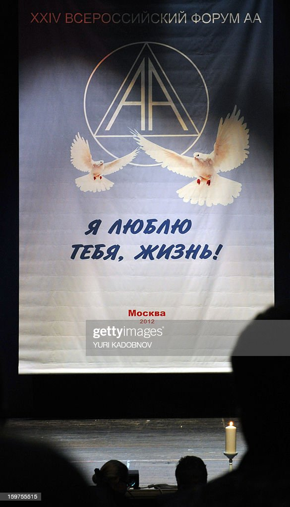 MAXIMOVA - Members of the Alcoholics Anonymous self-help group take part in a meeting in Moscow, on December 1, 2012. Twenty-five years after their arrival in Russia there are some 400 AA groups with 10.000 members in the country with 143 million people. The AA movement of 'mutual aid' groups created in the United States in the 1930s first came to Russia at the end of the 1980s during the perestroika era, as the country opened up under the last Soviet leader Mikhail Gorbachev. Yet more than 20 years later, Russia has just 400 AA groups with 10,000 members -- a tiny number for a population of 143 million where alcohol abuse and its social effects are a national scourge.