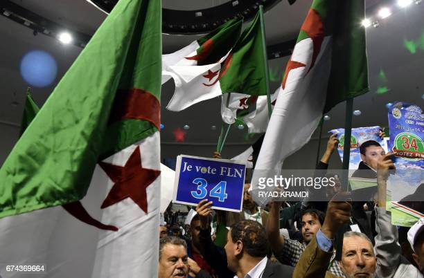 Members of the Algerian National Liberation Front gather at a party conference in the capital Algiers on April 28 while campaigning for the upcoming...