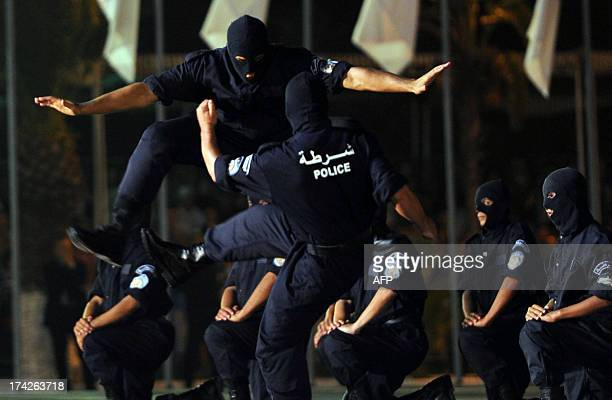 Members of the Algerian police forces perform in a show of force ceremony marking the fiftieth anniversary of the General Directorate of National...