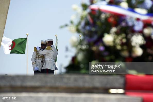 Members of the Algerian Republican Guards adjust their uniforms ahead of the arrival of French President Francois Hollande at the Martyr's Shrine in...