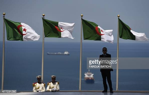 Members of the Algerian Republican Guards and a security offical stand guard at Martyr's Shrine in the Algerian capital Algiers on June 15 2015 ahead...