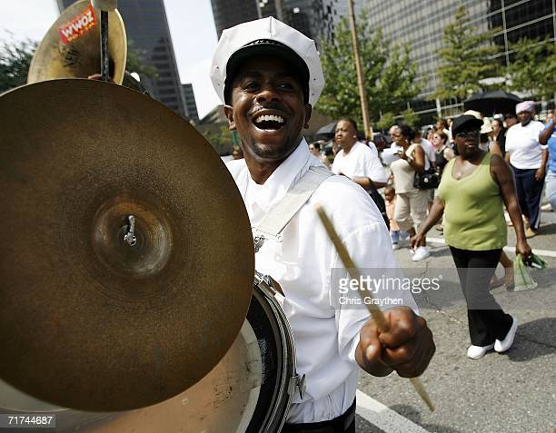 Members of the Algiers Brass Band play in a Jazz Funeral procession to mark the one year anniversary of Hurricane Katrina on August 29 2006 in New...