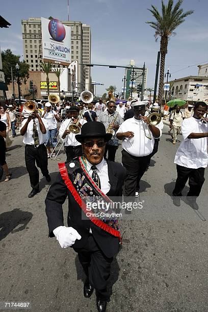 Members of the Algiers Brass Band play in a Jazz Funeral procession as they march down Canal Street to mark the one year anniversary of Hurricane...
