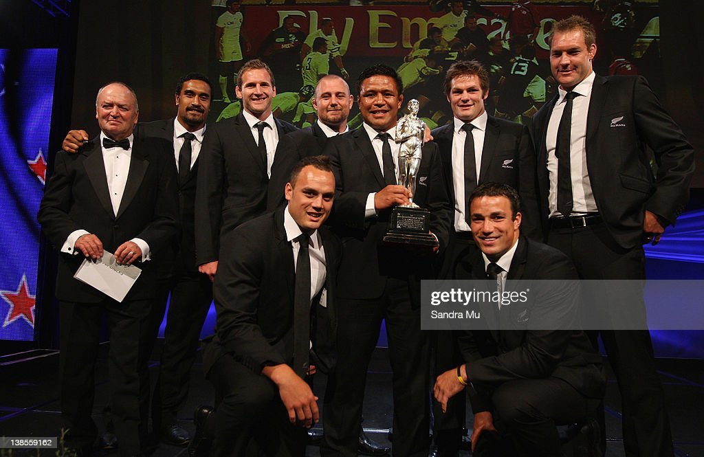 Members of the All Blacks pose on stage with the Supreme Halberg Award during the 2012 Halberg Awards at Sky City Convention Centre on February 9, 2012 in Auckland, New Zealand.