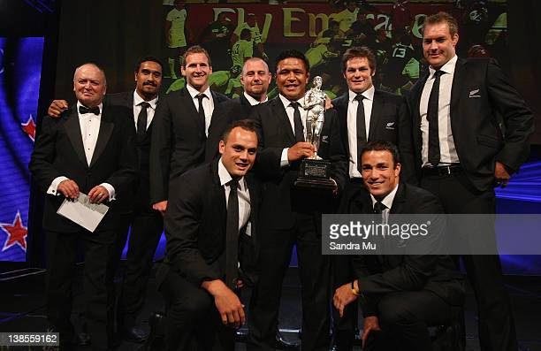 Members of the All Blacks pose on stage with the Supreme Halberg Award during the 2012 Halberg Awards at Sky City Convention Centre on February 9...