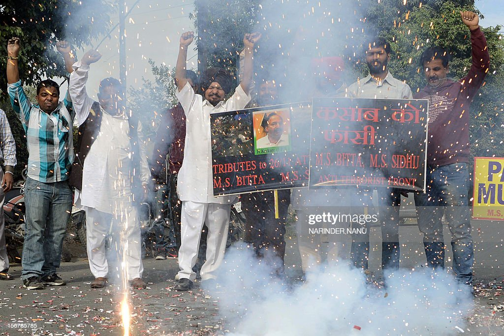 Members of the All India Anti Terrorist Front set off firecrackers as they celebrate the execution of Pakistanborn Mohammed Kasab who was the sole...