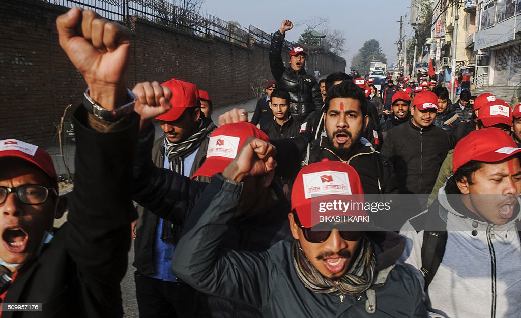 Members of the All Nepal Free Student Union Revolutionary movement, a sister wing of the Unified Maoist party, take part in a rally to mark the 21st Peoples War Day in Kathmandu on February 13, 2016. Nepal's former Maoist rebels paid tribute to fallen comrades February 13 in a ceremony marking 20 years since the start of an insurgency that transformed the Himalayan nation from a Hindu monarchy to a secular republic. AFP PHOTO / Bikash Karki / AFP / BIKASH KARKI
