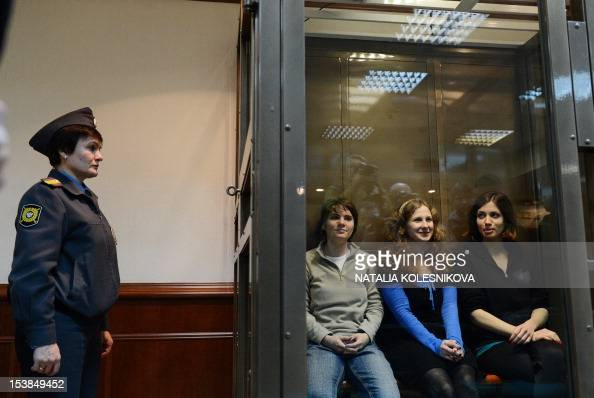 Members of the allgirl punk band 'Pussy Riot' Maria Alyokhina Yekaterina Samutsevich and Nadezhda Tolokonnikova sit in a glasswalled cage in a court...