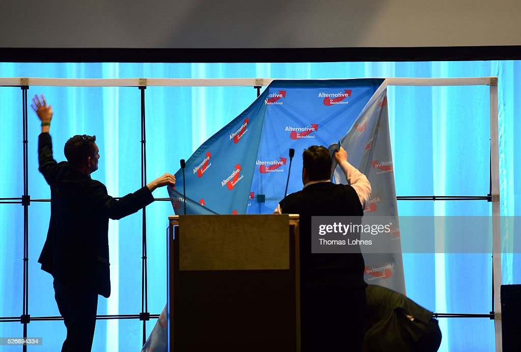 Members of the Alternative fuer Deutschland (AfD) political party take away the transparent with the party logo after he party's federal congress on May 01, 2016 in Stuttgart, Germany. The AfD, a relative newcomer to the German political landscape, has emerged from Euro-sceptic conservatism towards a more right-wing leaning appeal based in large part on opposition to Germany's generous refugees and migrants policy. Since winning seats in March elections in three German state parliaments the party has sharpened its tone, calling for a ban on minarets and claiming that Islam does not belong in Germany.