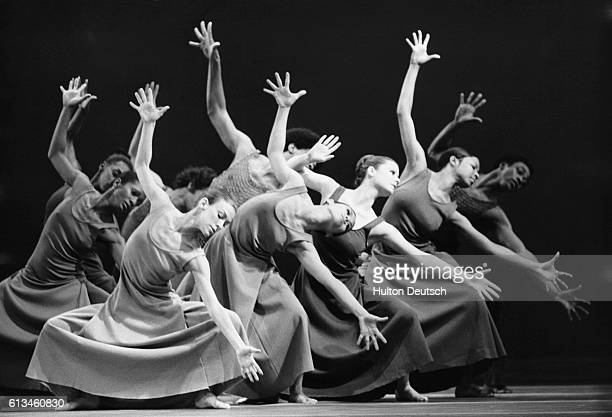 Members of the Alvin Ailey American Dance Theatre rehearse a scene in a dance called Revelations