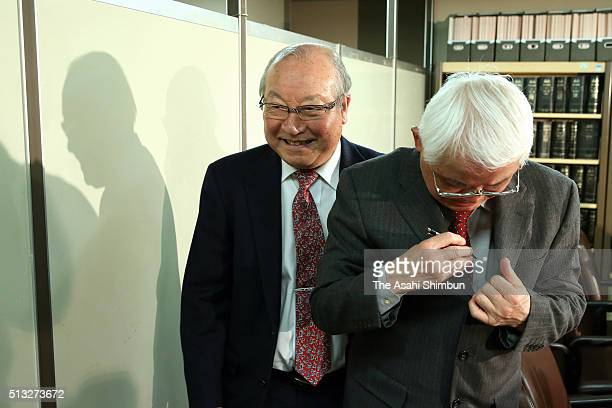Members of the Alzheimer's Association Japan smile during a press conference after the Supreme Court ruling on March 1 2016 in Tokyo Japan The...
