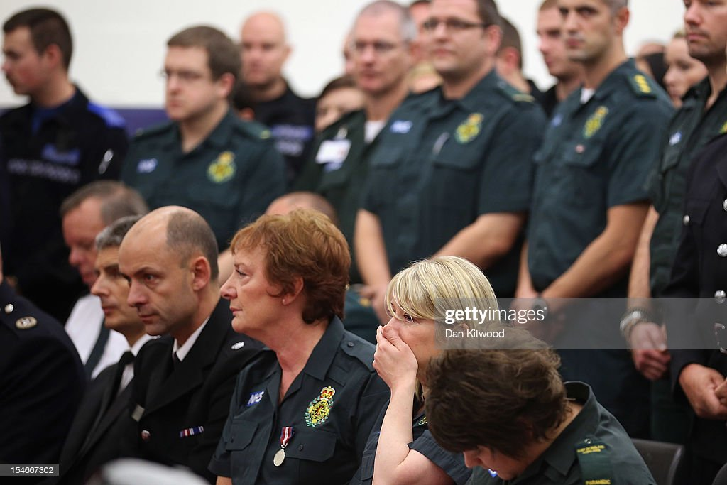 Members of the Ambulance Services react during a service of prayer for Sabah Usmani and her five children, who were killed in a house fire on October 24, 2012 in Harlow, England. Dr Sabah Usmani and her sons Sohaib, 11, and Rayyan, 6, and daughter Hira, 13, died in a house fire in Harlow on October 15. Her other son, Muneeb, 9, and daughter Maheen, 3, both died later in hospital. Her husband, who was released from hospital last week, lead the funeral at Harlow Islamic Centre, which was attended by some 200 mourners.