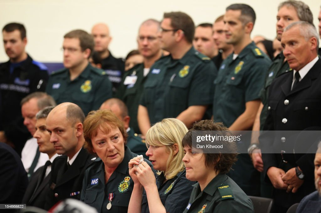 Members of the Ambulance Services react during a service of prayer for the family of Sabah Usmani and her five children, who were killed in a house fire on October 24, 2012 in Harlow, England. Dr Sabah Usmani and her sons Sohaib, 11, and Rayyan, 6, and daughter Hira, 13, died in a house fire in Harlow on October 15. Her other son, Muneeb, 9, and daughter Maheen, 3, both died later in hospital. Her husband, who was released from hospital last week, lead the funeral at Harlow Islamic Centre, which was attended by some 200 mourners.