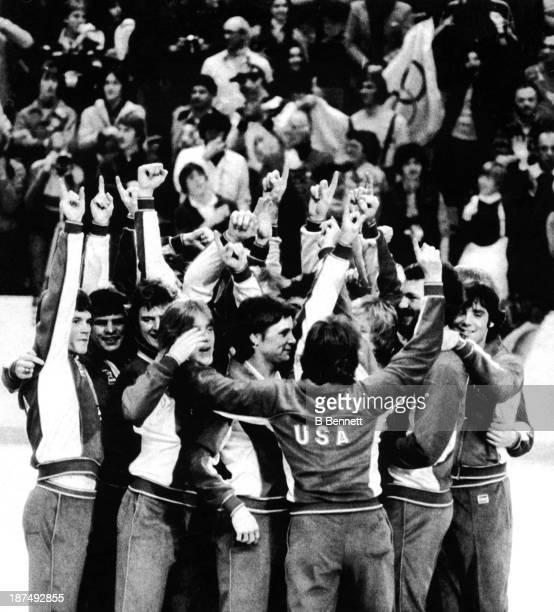Members of the American hockey team crowd onto the center podium as they give the 'Number 1' sign at their Olympic medal ceremony on February 24 1980...
