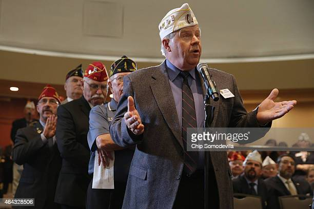 Members of the American Legion line up to ask US Veterans Affairs Secretary Robert McDonald questions during the legion's annual conference at the...