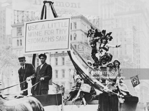 Members of the American Liberties League parading on a horse drawn cart to protest against Prohibition the banner reads 'Use A Little Wine For Thy...