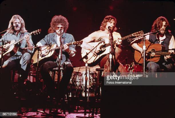 Members of the American softrock ensemble The Eagles sit on chairs as the perform on the television show 'Don Kirschner's Rock Concert' 1979...