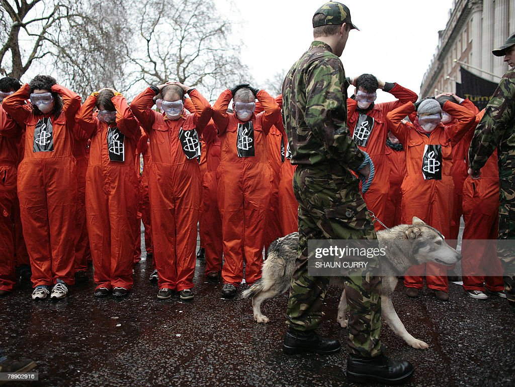 Members of the Amnesty International human rights organization stage a protest outside the US Embassy in London 11 January 2008 against the US military prison camp in Guantanamo Bay. The London-based human rights group demanded the war-on-terror facility be finally closed, six years on since the first detainees arrived 11 January 2002. AFP PHOTO/SHAUN CURRY