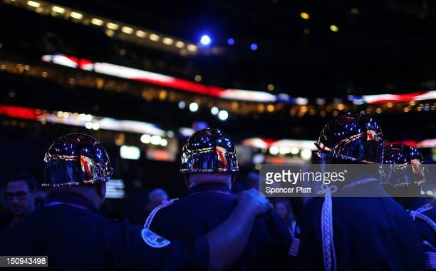 Members of the Amputee Veterans of America wearing helmets prepare to present the colors before the start of the third day of the Republican National...