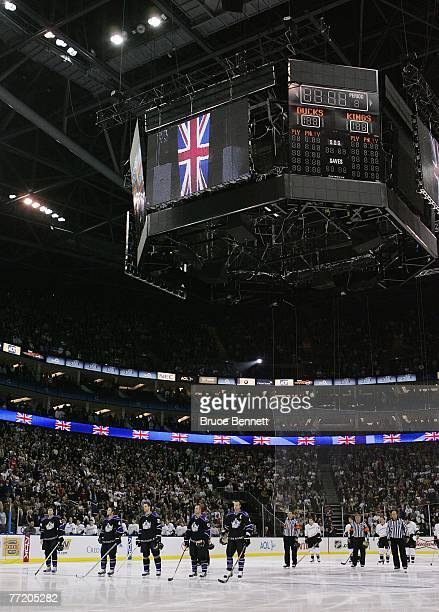 Members of the Anaheim Ducks and the Los Angeles Kings stand at attention during the playing of the national anthem prior to their NHL game on...