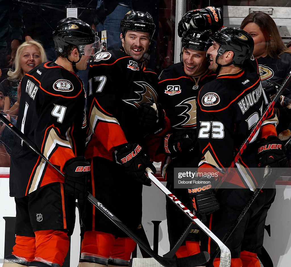 Members of the Anaheim Ducks celebrate a goal during a game against the Buffalo Sabres at Honda Center on November 8, 2013 in Anaheim, California.