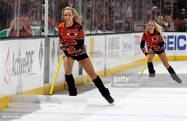Members of the Anaheim Ducks Power Players tend to the ice during the game between the Anaheim Ducks and the Carolina Hurricanes on December 11 2015...