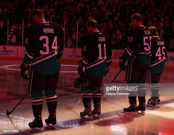 Members of the Anaheim Ducks stand in observance of the national anthem prior to a game against the Ottawa Senators at Honda Center on October 13...