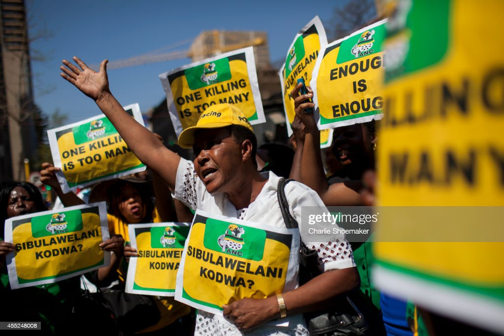 Members of the ANC Women's League protest Oscar Pistorius outside the North Gauteng High Court on September 11 2014 in Pretoria South Africa Judge...
