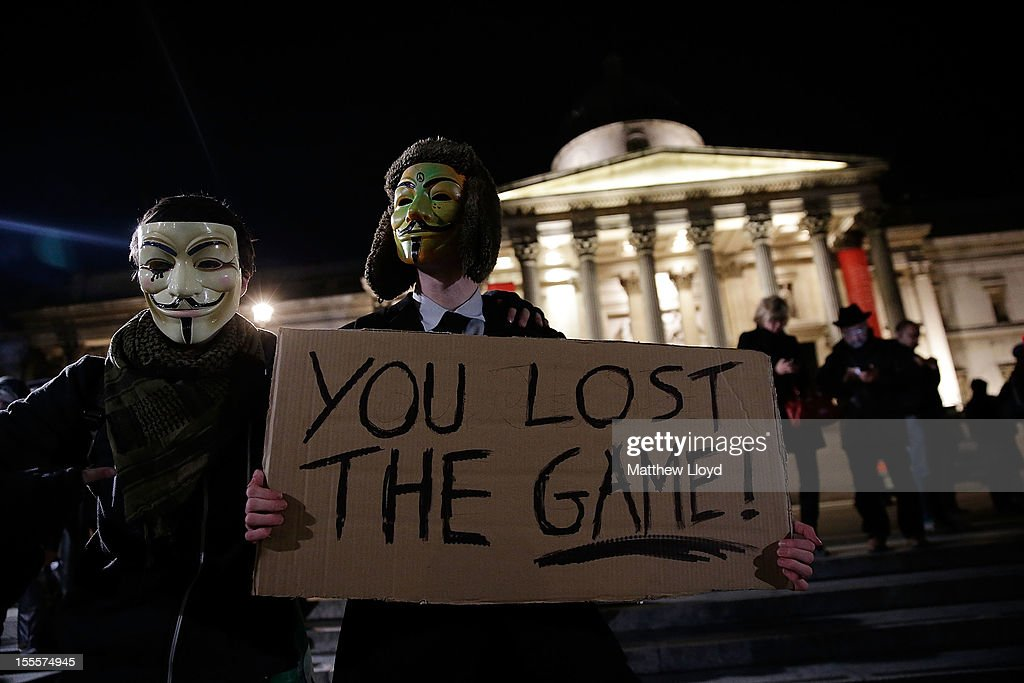 Members of the Anonymous group gather in Trafalgar Square before marching to the Houses of Parliament on November 5, 2012 in London, England. The group wear masks inspired by a character from the film 'V for Vendetta', which culminates in the march en masse of the public against parliament, in protest against an authoritarian goverment, on the fifth of November.