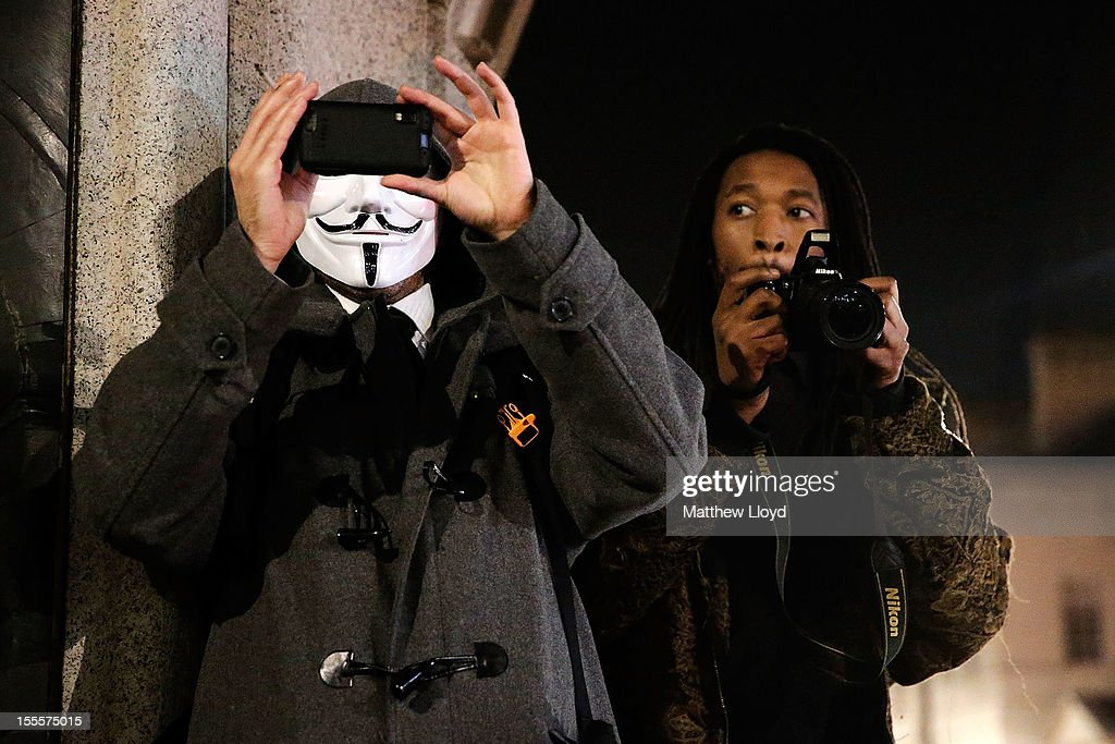 Members of the Anonymous group gather in Trafalgar Square before marching to the Houses of Parliament on November 5, 2012 in London, England. The group wear masks inspired by a character from the film 'V for Vendetta', which culminates in the march en masse of the public against parliament, in protest against a authoritarian goverment, on the fifth of November.